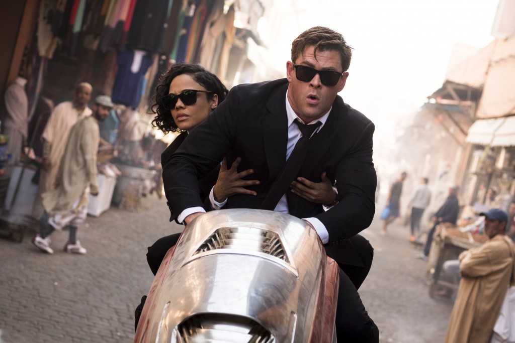 "This image released by Sony Pictures shows Chris Hemsworth, foreground, and Tessa Thompson in a scene from Columbia Pictures' ""Men in Black: Internati..."