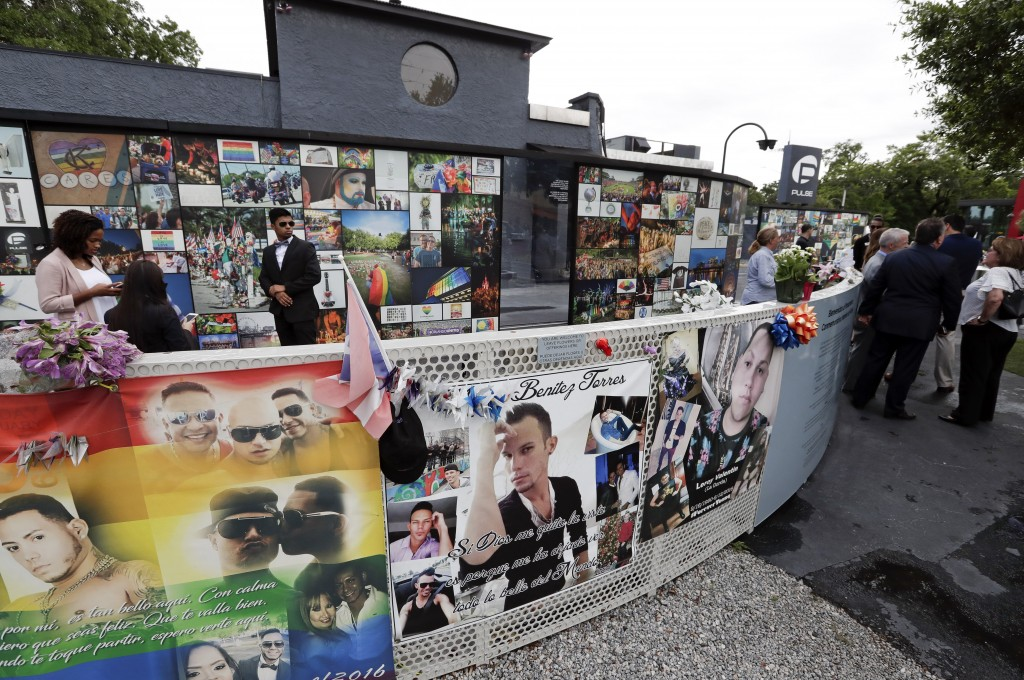 People gather at the Pulse nightclub before a news conference to introduce legislation that would designate the site as a national memorial, Monday, J...