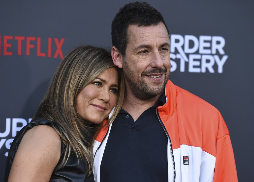 """Cast members Jennifer Aniston and Adam Sandler arrive at the Los Angeles premiere of """"Murder Mystery"""" at the Regency Village Theatre on Monday, June 1"""