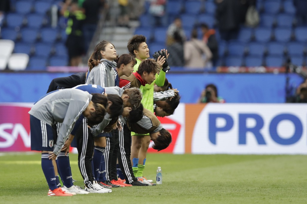 Japan players bow to fans at the end of the Women'...