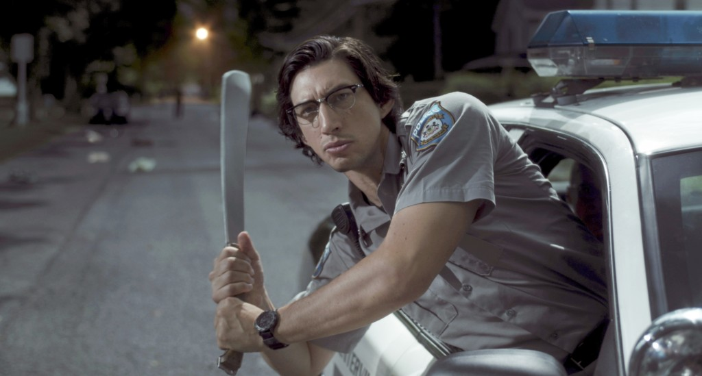 "In this image released by Focus Features shows Adam Driver as ""Officer Ronald Peterson""  in a scene from ""The Dead Don't Die."" ( Frederick Elmes /Focu"