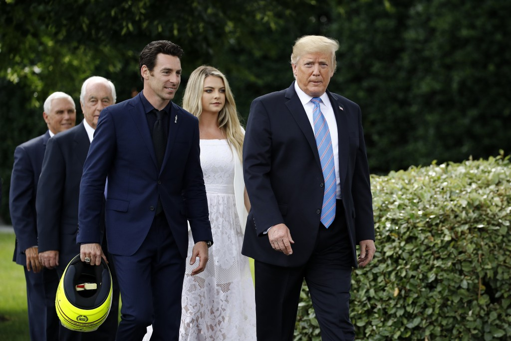 President Donald Trump walks with driver Simon Pagenaud to the South Lawn at the White House, Monday, June 10, 2019, in Washington for an event to hon
