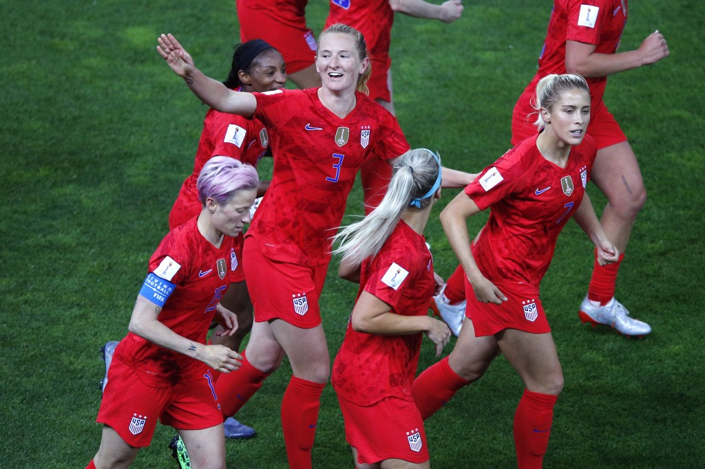 United States' Samantha Mewis celebrates after scoring her team's fourth goal during the Women's World Cup Group F soccer match between the United Sta