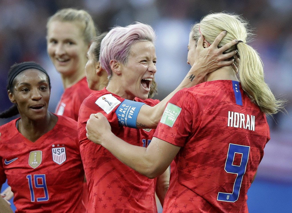 United States' scorer Lindsey Horan, right, celebrates their side's 3rd goal with Megan Rapinoe during the Women's World Cup Group F soccer match betw...