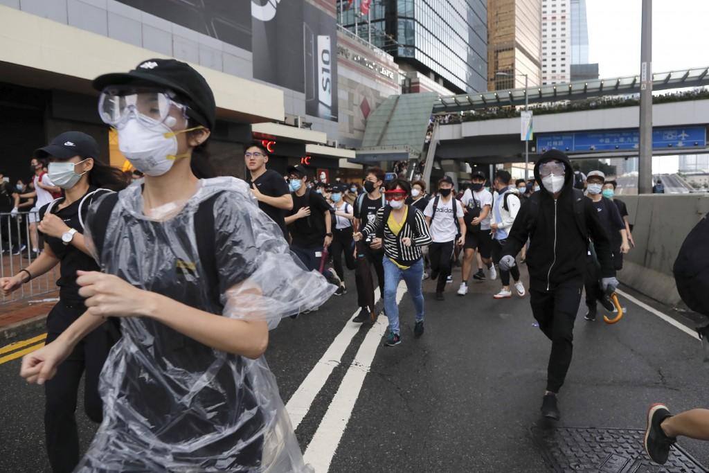 In this June 12, 2019, file photo, protestors run near the Legislative Council in Hong Kong. (AP Photo/Kin Cheung, File)