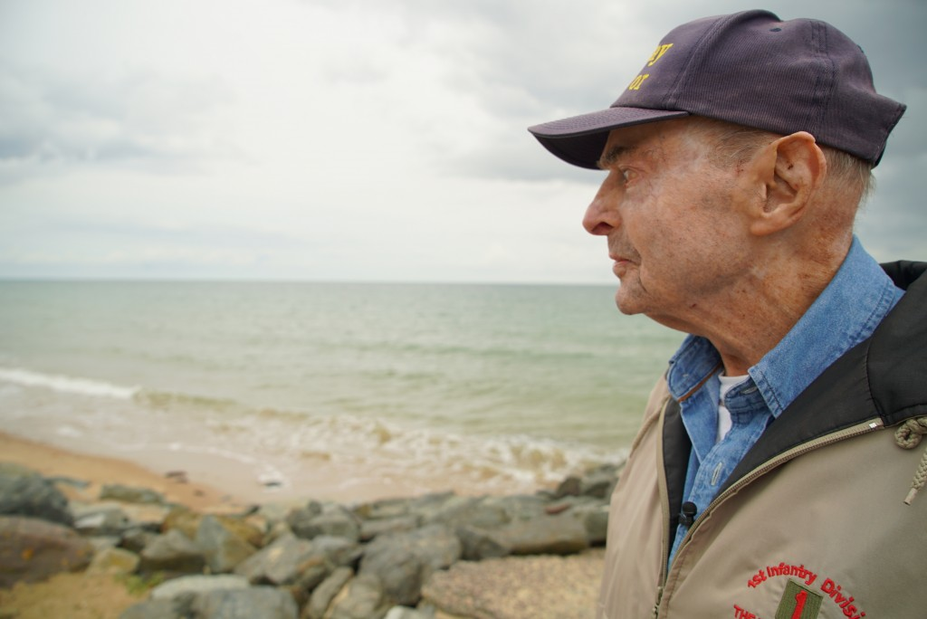 D-Day survivor Ray Lambert looks out over Omaha Beach in Colleville-sur-Mer, France, on Wednesday, June 5, 2019. The North Carolina man was wounded fo