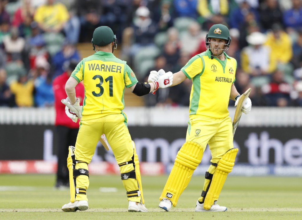 Australia's captain Aaron Finch, right is congratulated by teammate Australia's David Warner after getting 50 runs not out during the Cricket World Cu