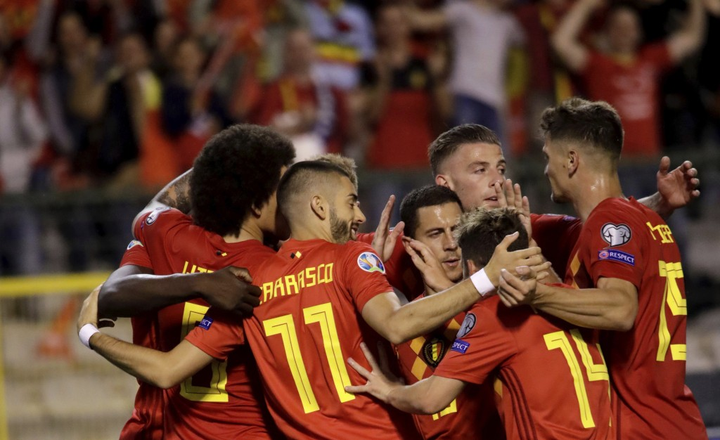 Belgium's team players celebrate after winning a Euro 2020 group I qualifying soccer match between Belgium and Scotland at the King Baudouin Stadium i