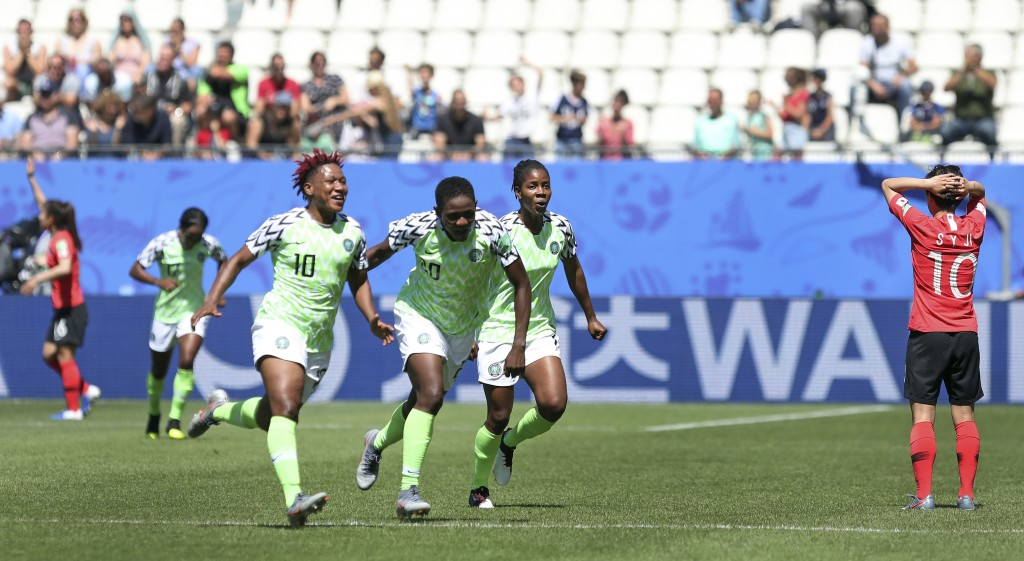 Nigeria players celebrate after taking the lead after South Korea's Kim Do-yeon scored an own goal during the Women's World Cup Group A soccer match b
