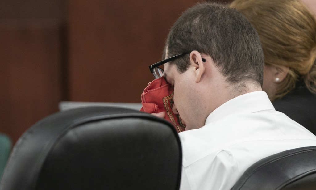 Timothy Jones Jr. wipes his eyes as his ex-wife Amber Kyzer, mother of five children who were killed by their father, Jones, during the sentencing pha