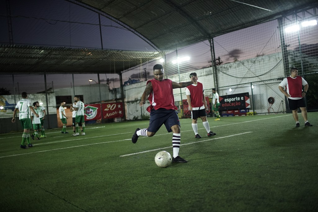 In this May 27, 2019 photo, Bruno Pereira prepares to kick during a pause at a soccer match between his team, the Bigtboys transgender men's team agai...