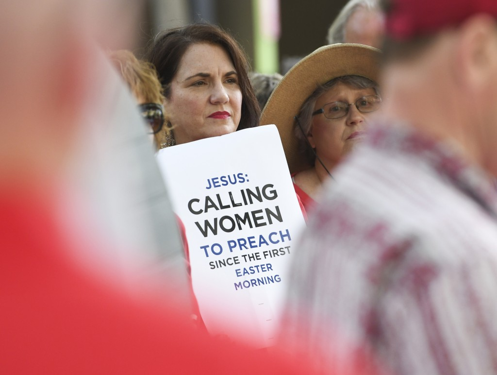 Janene Cates Putman of Athens, Tenn., demonstrates outside the Southern Baptist Convention's annual meeting Tuesday, June 11, 2019, during a rally in