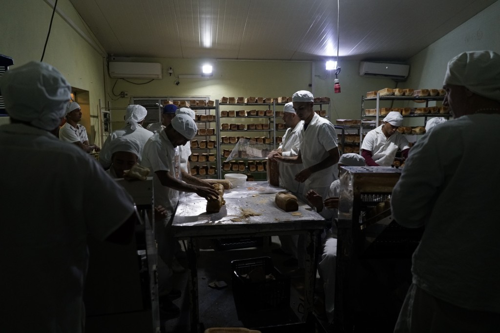 In this May 15, 2019 photo, inmates work at a bakery at the Punta de Rieles prison, in Montevideo, Uruguay. This bakery was started by two prisoners w...