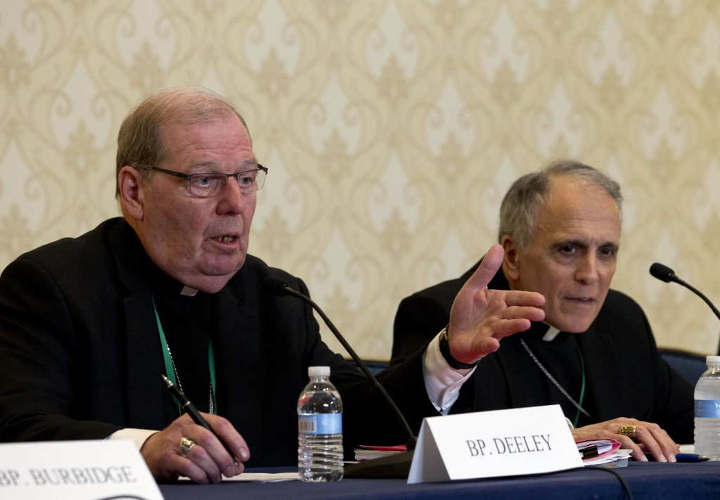 Robert Deeley, left, Bishop of the Diocese of Portland, accompanied by Cardinal Daniel DiNardo, of the Archdiocese of Galveston-Houston and President