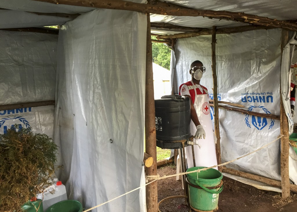 This photo taken Monday, June 10, 2019 and released by the International Rescue Committee (IRC), shows an Ebola screening checkpoint where people cros...