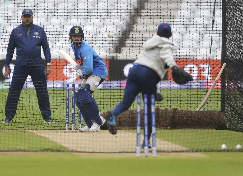 Indian team coach Ravi Shastri, left, watches captain Virat Kohli, center, bat in the nets during a training session ahead of their Cricket World Cup ...