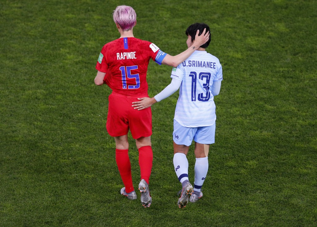 Thailand's Orathai Srimanee congratulates United States' Megan Rapinoe, left, after their Women's World Cup Group F soccer match between the United St