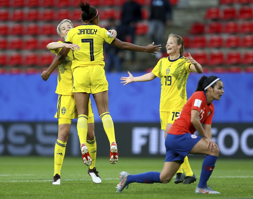 Sweden's Madelen Janogy, 2nd left, celebrates after scoring her side's 2nd goal during the Women's World Cup Group F soccer match between Chile and Sw...