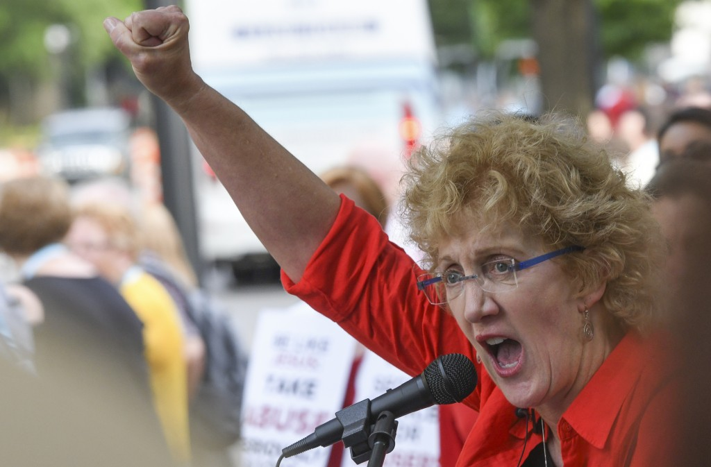 Christa Brown, of Denver, Colo., speaks outside the Southern Baptist Convention's annual meeting Tuesday, June 11, 2019, during a rally in Birmingham,