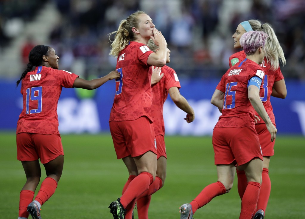 United States' scorer Samantha Mewis, center, and her teammates celebrate their side's 4rth goal during the Women's World Cup Group F soccer match bet