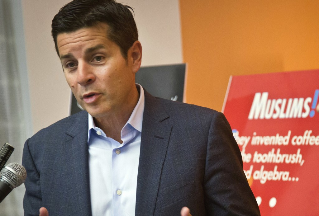 FILE - In this June 25, 2015 file photo, Muslim comedian Dean Obeidallah speaks at a news conference in New York. A federal judge will hear arguments ...