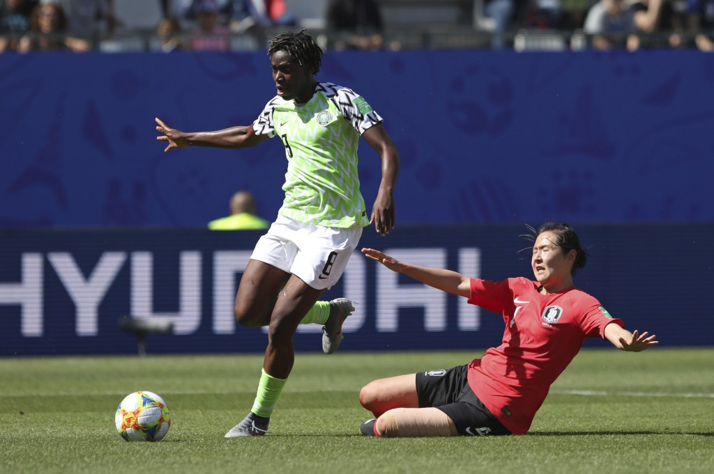 Nigeria's Asisat Oshoala gets away from South Korea's Hwang Bo-ram on her way to scoring her side's second goal during the Women's World Cup Group A s