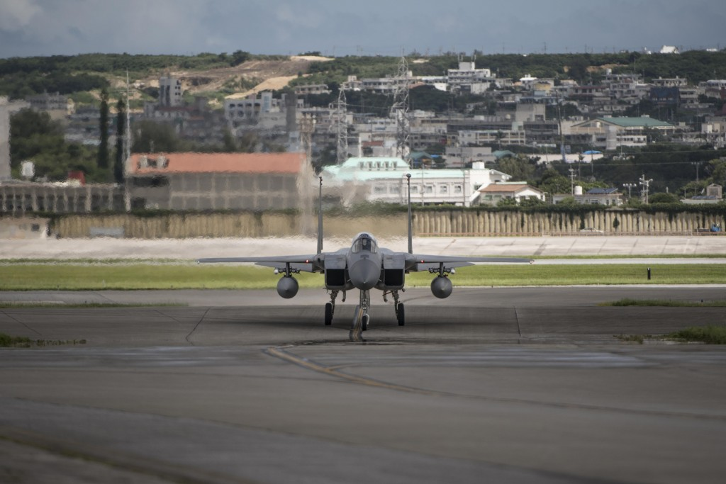 In this June 29, 2017 photo made available by the U.S. Air Force, an F-15 fighter plane taxis back to the hangar at Kadena Air Base, Japan. The Defens...