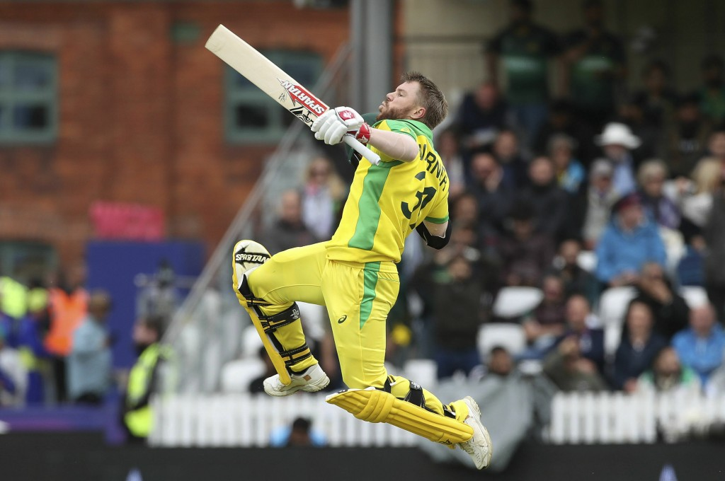 Australia's David Warner celebrates his century during the Cricket World Cup group stage match against Pakistan at the County Ground Taunton, England,