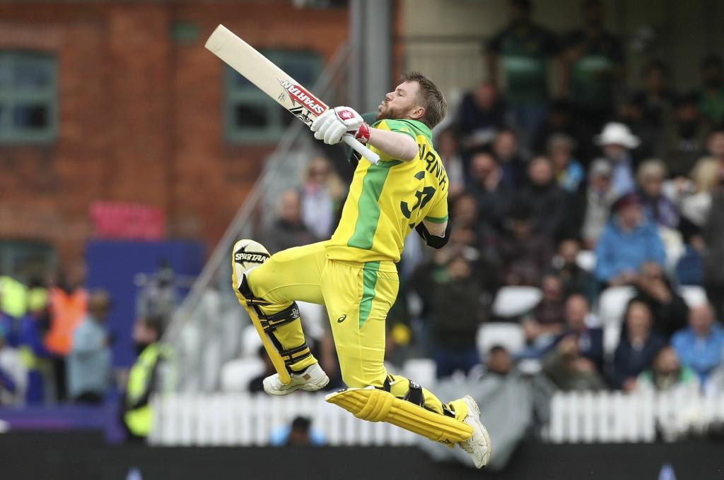 Australia's David Warner celebrates his century du...