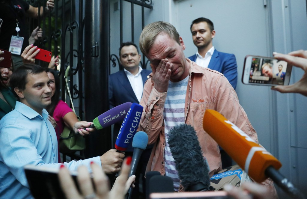 Prominent Russian investigative journalist Ivan Golunov, cries as he leaves a Investigative Committee building in Moscow, Russia, Tuesday, June 11, 20