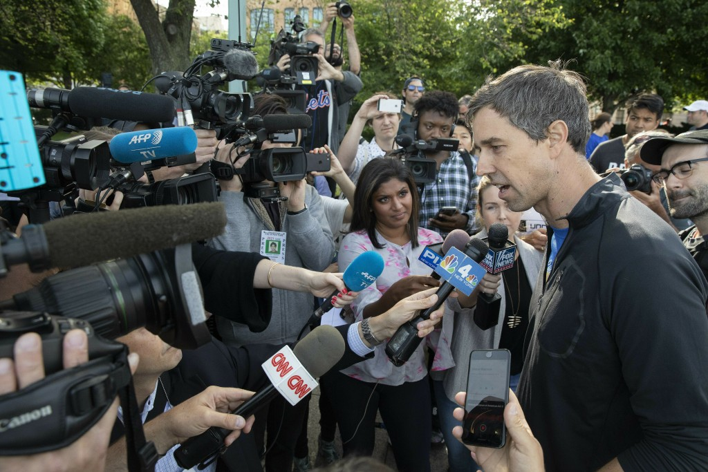 Democratic presidential candidate Beto O'Rourke talks to the media after participating in a 2-mile run with members and friends of the LGBTQ community