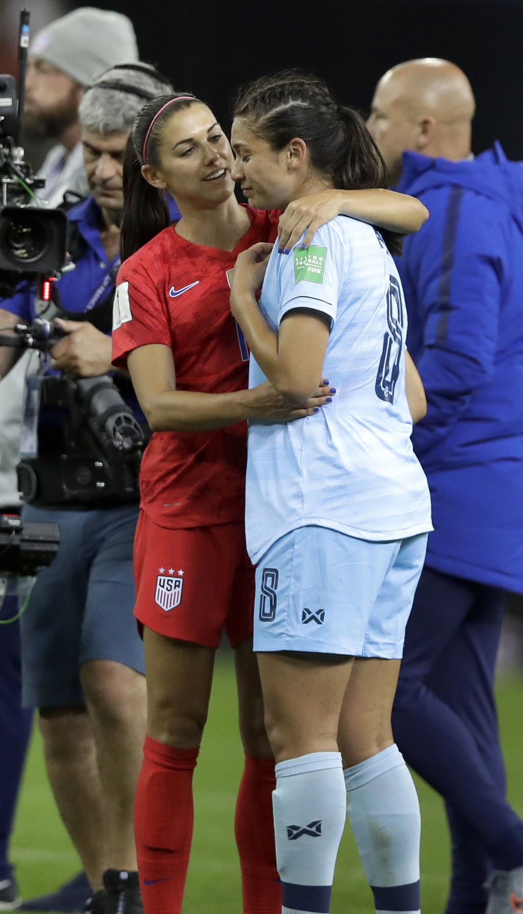 United States' Alex Morgan, left, comforts Thailand's Miranda Nild, right, after the Women's World Cup Group F soccer match between United States and ...