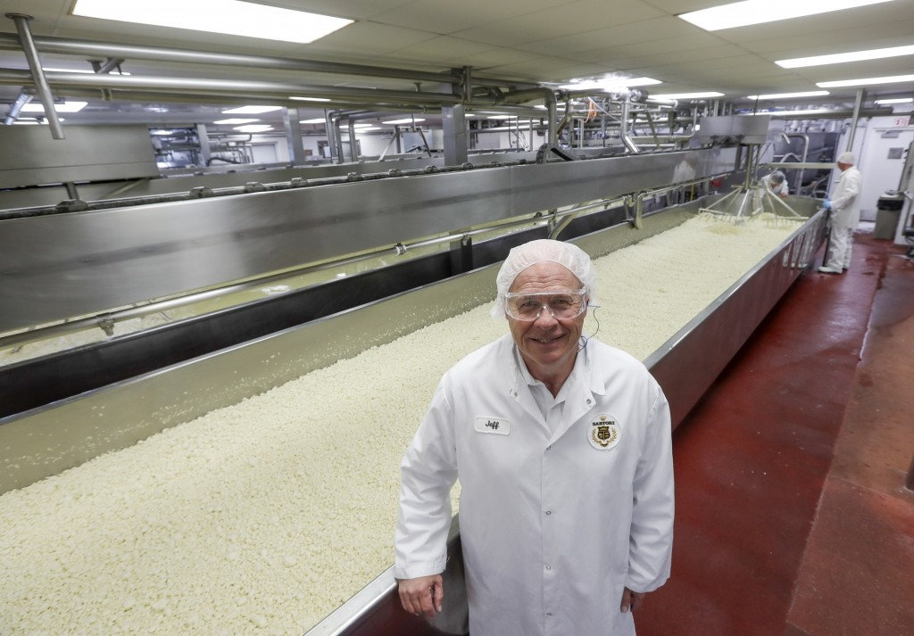 In this June 7, 2019, photo Jeff Schwager , president of Sartori Cheese poses for a picture at their plant in Plymouth, Wis. Schwager's company, Sarto