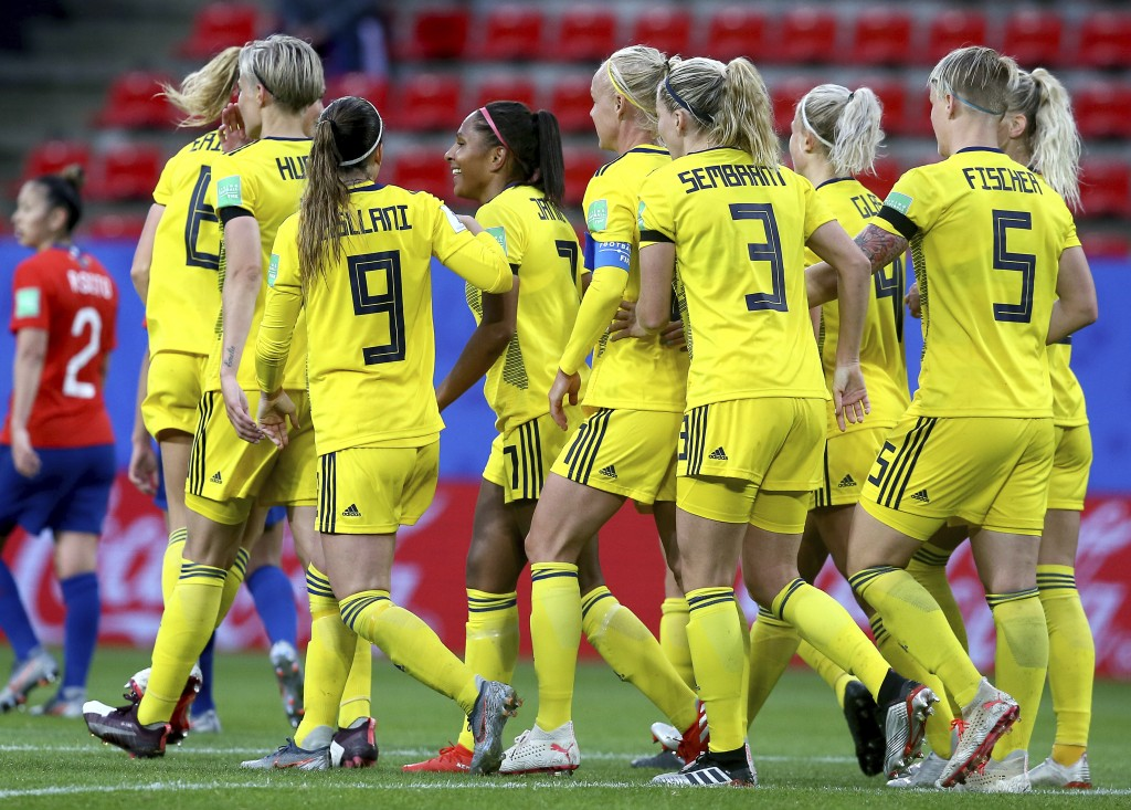 Sweden's Madelen Janogy, 4th left with red hairband, celebrates after scoring her side's 2nd goal during the Women's World Cup Group F soccer match be...