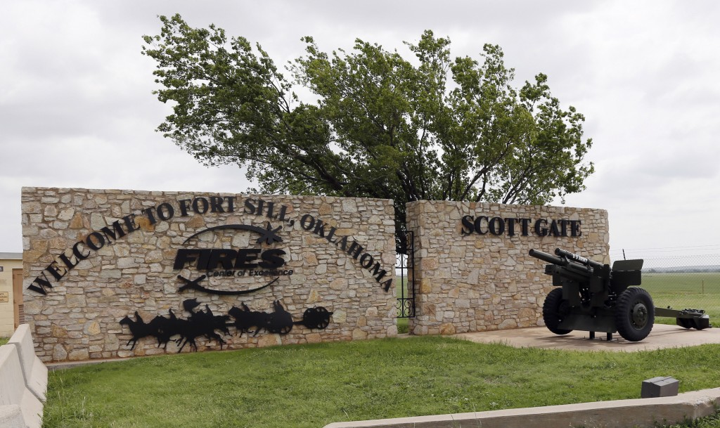 FILE - This June 17, 2014 file photo shows an entrance to Fort Sill near Lawton, Okla. The federal government has chosen the military base in Oklahoma