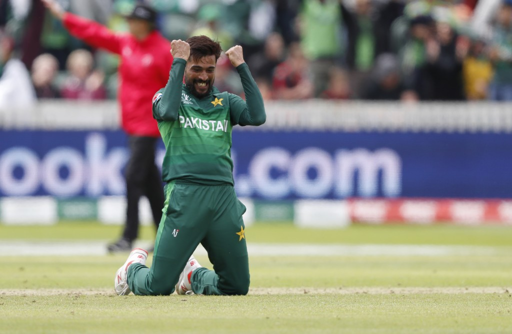 Pakistan's Mohammad Amir celebrates after taking the wicket of Australia's Mitchell Starc during the Cricket World Cup match between Australia and Pak...