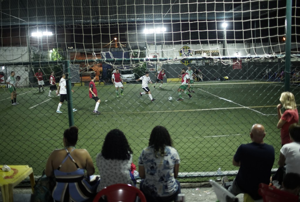 In this May 27, 2019 photo, girlfriends and friends watch a soccer game between the Bigtboys transgender men's team and the Alligaytors, a gay men's t...