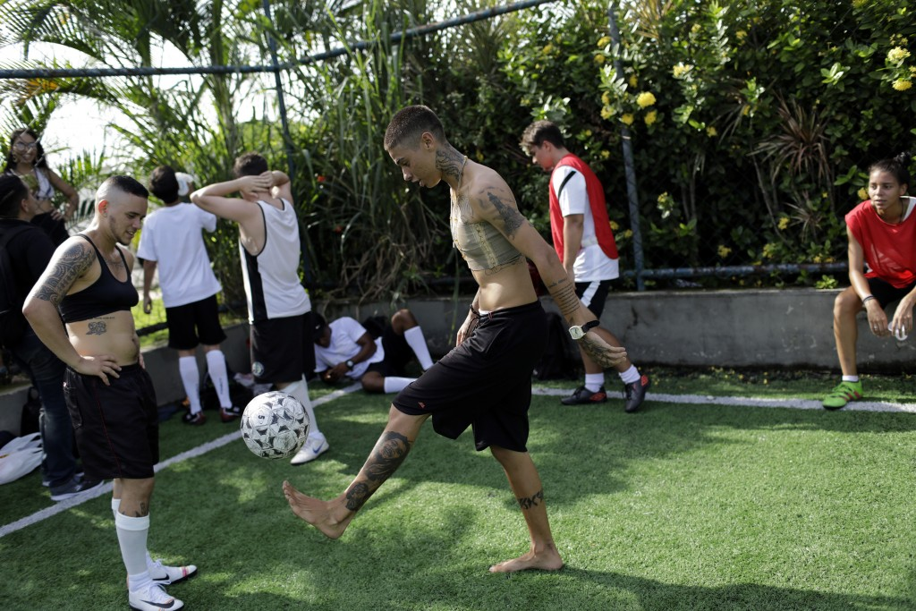 In this May 13, 2019 photo, Caua Fraga kicks the ball during a practice session with the Bigtboys transgender men's soccer team in Rio de Janeiro, Bra...