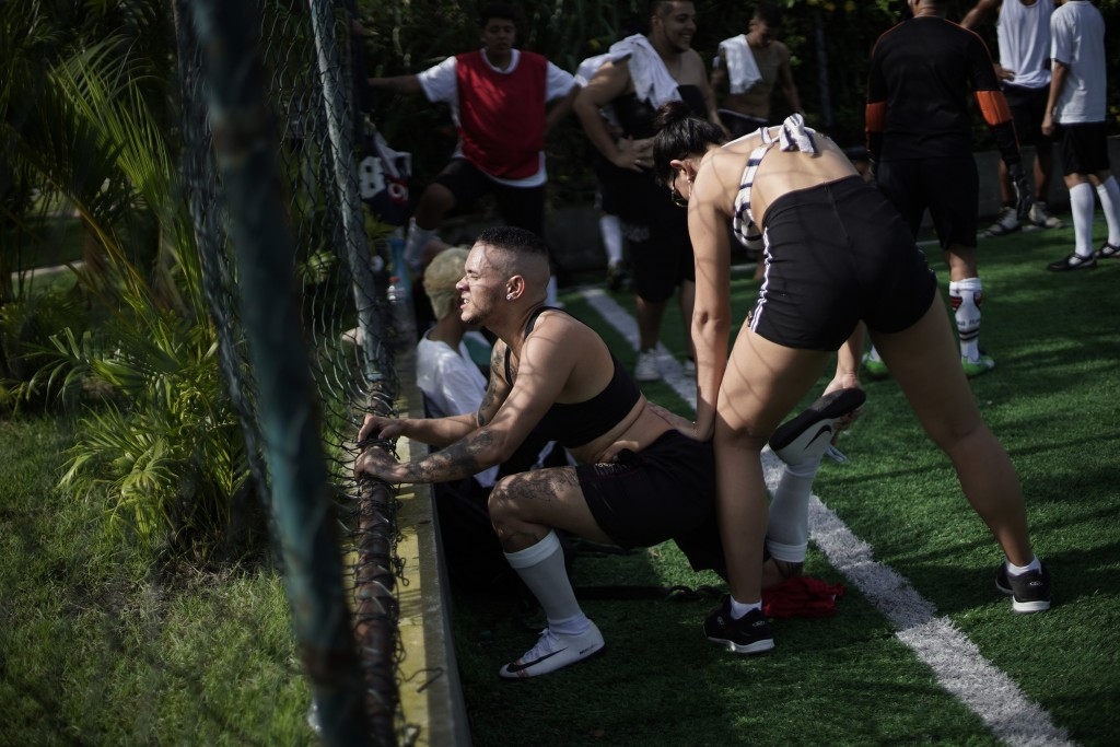 In this May 13, 2019 photo, Daniel de Farias Viana stretches during a practice session with his transgender, men's soccer team Bigtboys in Rio de Jane...