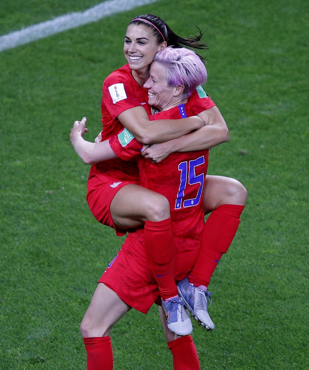 United States' Megan Rapinoe, right, congratulates teammate Alex Morgan after scoring her fifth goal during the Women's World Cup Group F soccer match
