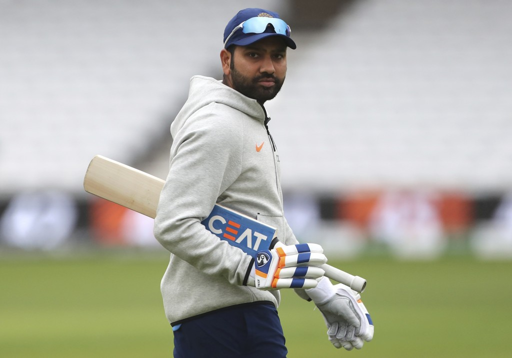 India's Rohit Sharma arrives to bat in the nets during a training session ahead of their Cricket World Cup match against New Zealand at Trent Bridge i...