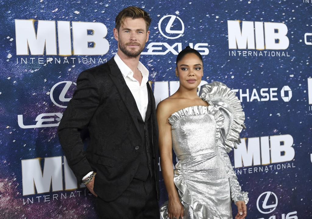 "Actors Chris Hemsworth, left, and Tessa Thompson attend the world premiere of ""Men in Black: International,"" at the AMC Loews Lincoln Square, Tuesday,"