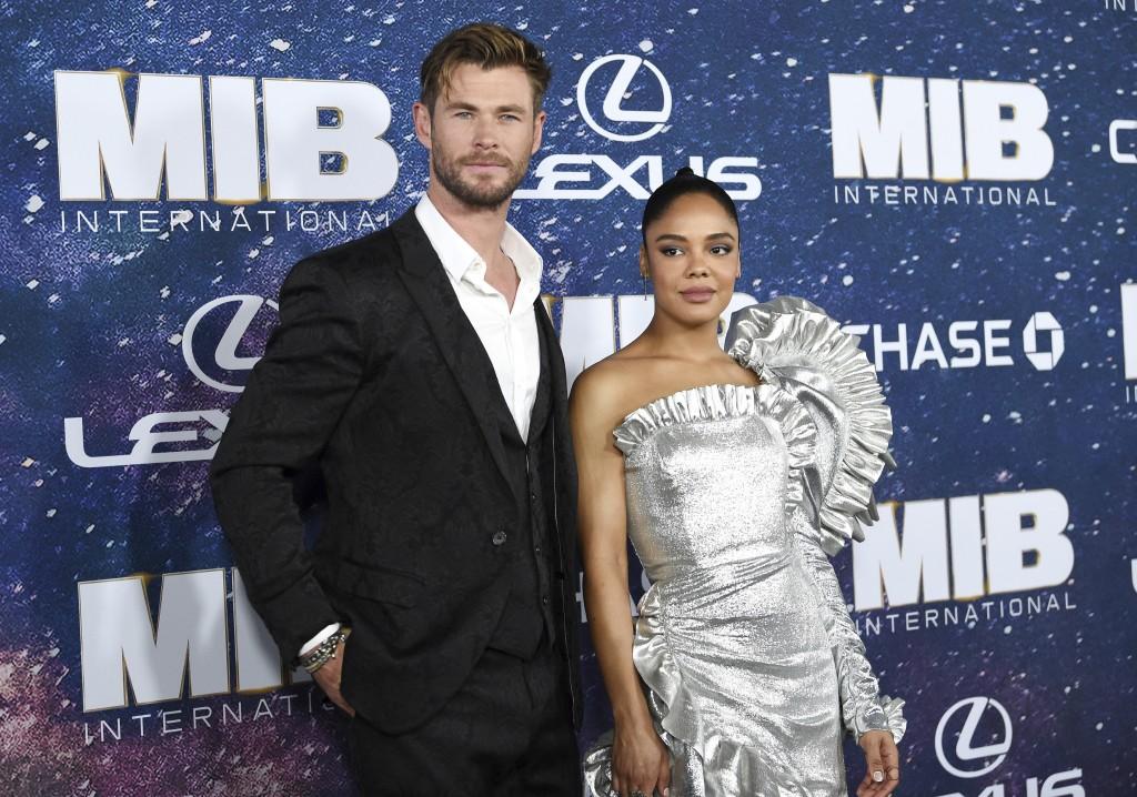 Actors Chris Hemsworth, left, and Tessa Thompson a...