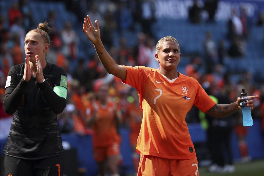 Netherlands' Shanice Van De Sanden, right, and Net...