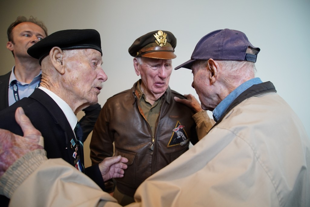 D-Day survivor Ray Lambert, right, talks with fellow World War II veterans Roy O'Neill of Great Britain, left, and Jim Kunkel of California during a r