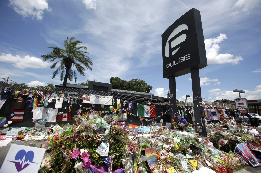 FILE - In this July 11, 2016, file photo, a makeshift memorial continues to grow outside the Pulse nightclub in Orlando, the day before the one month
