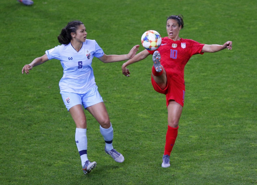 United States' Carli Lloyd attempts to control the ball as Thailand's Miranda Nild , left, watches during the Women's World Cup Group F soccer match b