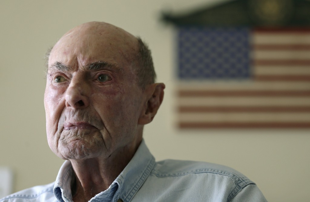 Ray Lambert, 98, a U.S. Army combat veteran who landed at Normandy on D-Day as a medic with the First Infantry Division, sits for a portrait in West E
