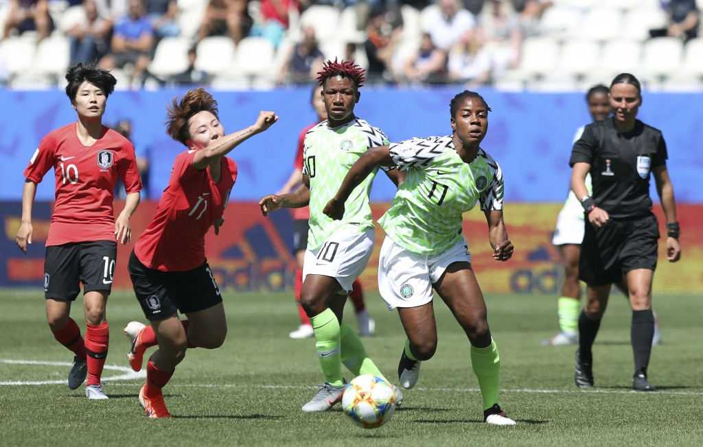 South Korea's Jung Seol-bin, left, challenges Nigeria's Chinaza Uchendu during the Women's World Cup Group A soccer match between Nigeria and South Ko