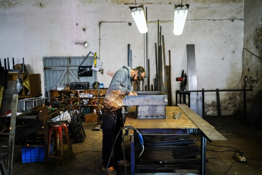 In this May 20, 2019 photo, former inmate Mauro Rodríguez works at the blacksmith shop at the Punta de Rieles prison in Montevideo, Uruguay. Rodríguez...